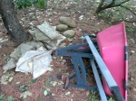 Overturned Red Wheelbarrow Beside the Grey Stones
