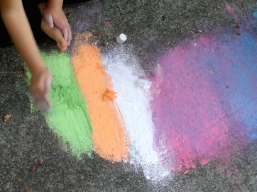Scooping mounds of chalk dust.