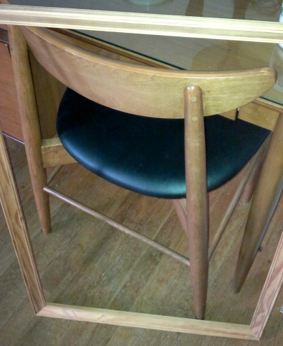 Frame leaning against table and chair